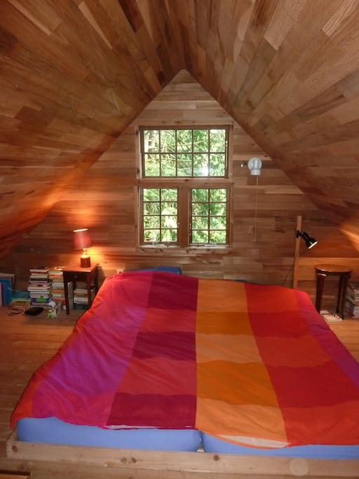 Sleeping loft with high density foam mattress.  Lot of books!