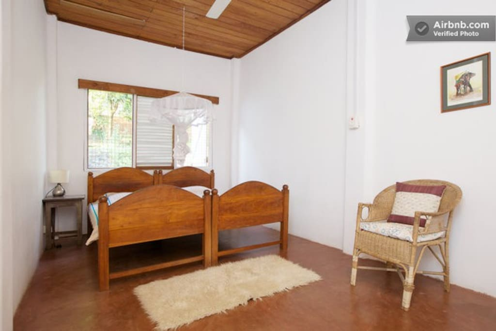Twin or Double Room, with fan and mosquito net, can include another single bed in here too.