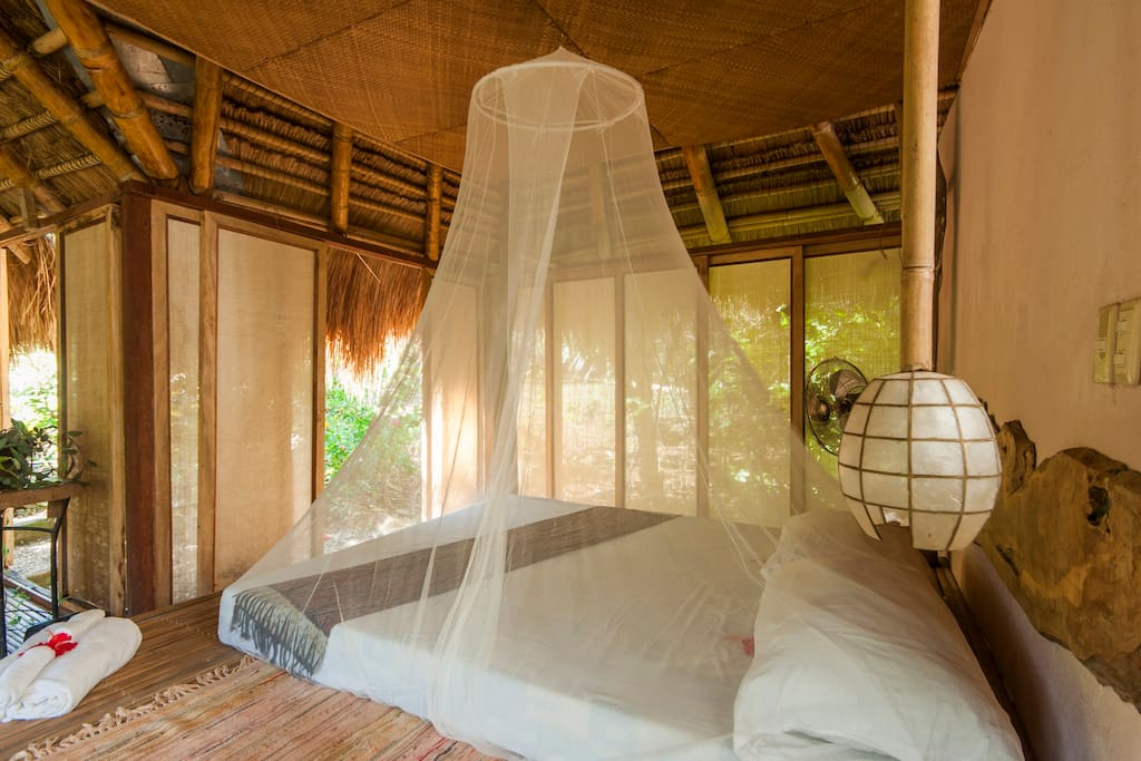 Light and air circulate throughout the villa which is surrounded on three sides by glass doors.
