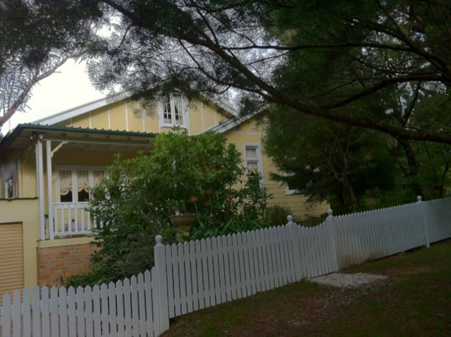 Traditional cottage with white picket fence