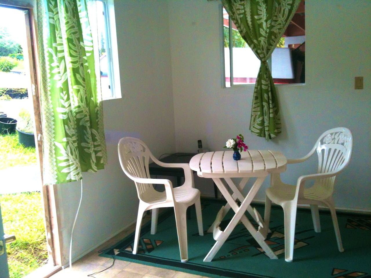 Your bright kitchenette, where you can eat fresh papayas and bananas.