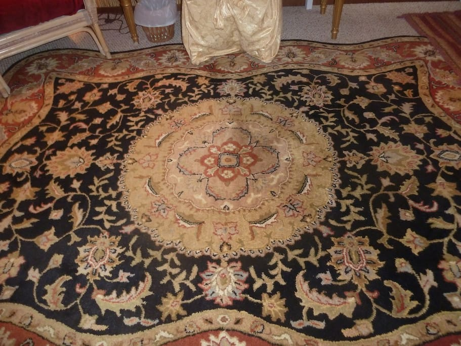 The beautiful Persian rug, which centers the entire room.