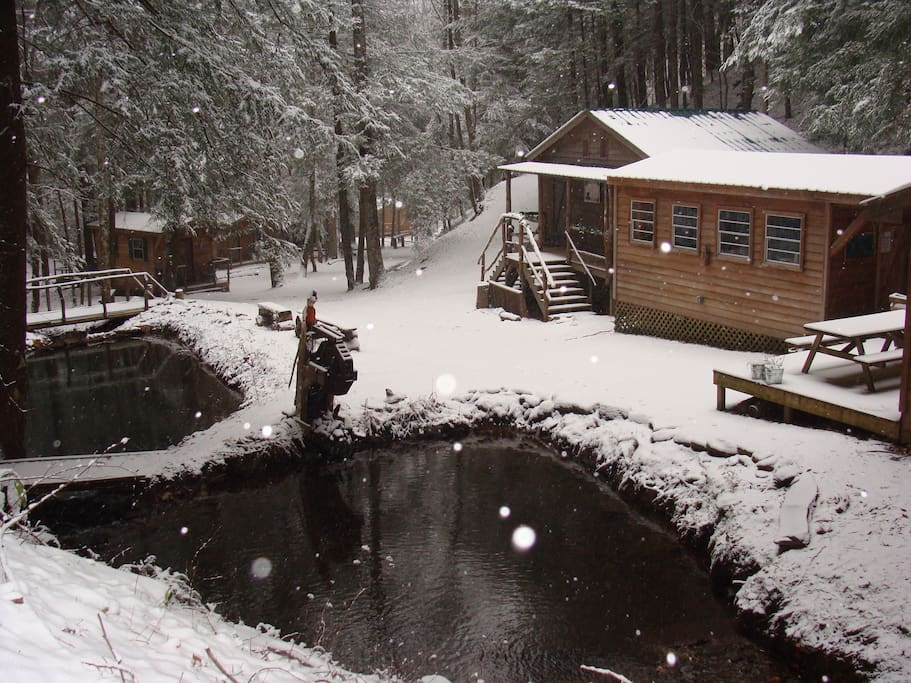 View of camp area - dining hall, camp kitchen, bath house, cabins, koi & trout ponds fed by natural springs