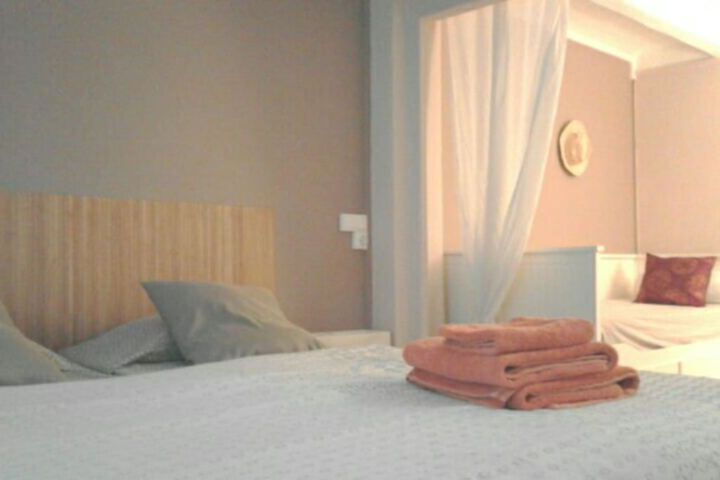 One bedroom with private bathroom and 3 beds