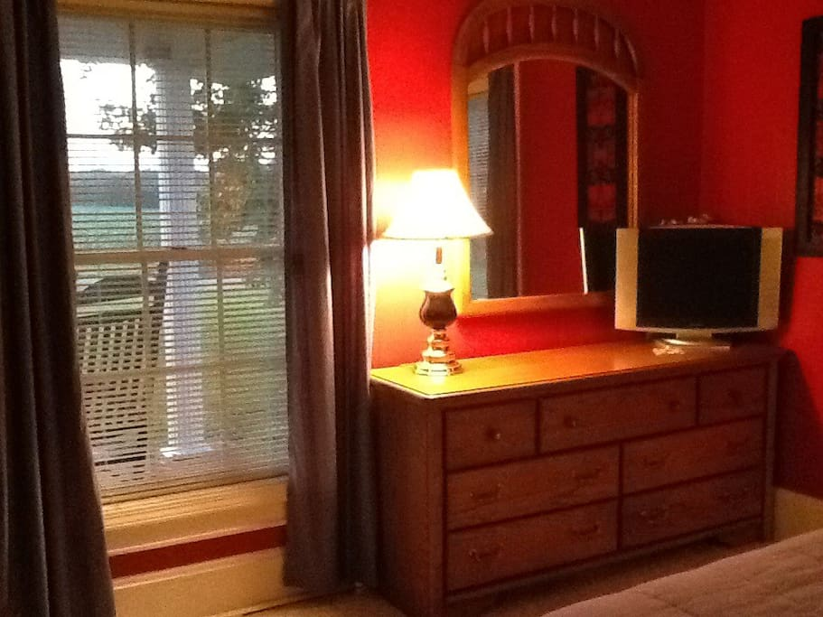 Dresser with mirror and window onto front porch