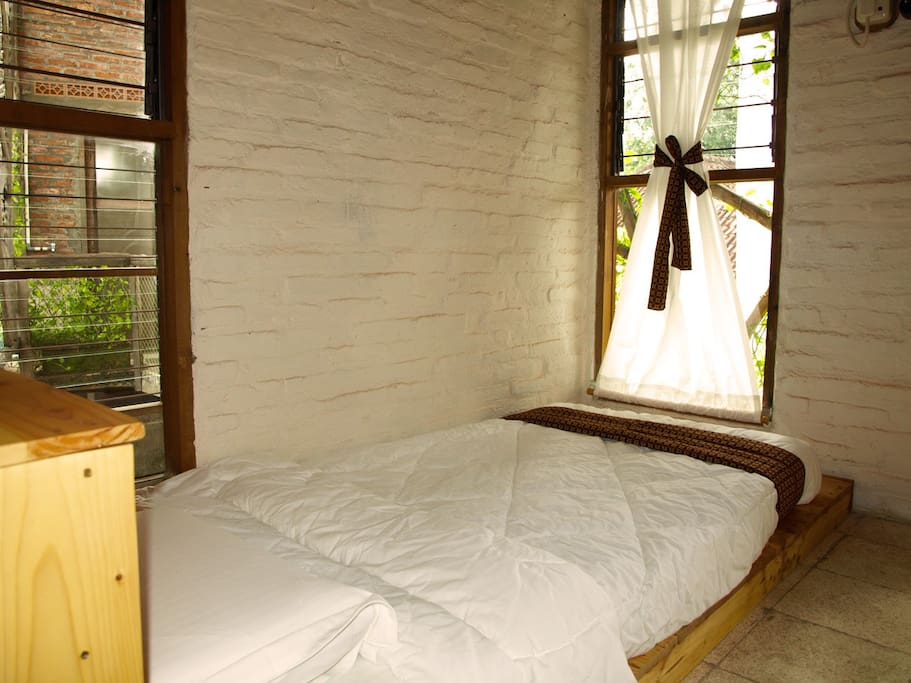 One Bed With Local Braided Bamboo Wall: Comfortable room with natural and healthy full latex bed, work-desk, seating area, local furnishings, A/C, free high-speed internet.