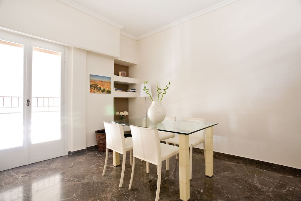 Dining table for four, modern furniture and minimal design in all areas of the apartment