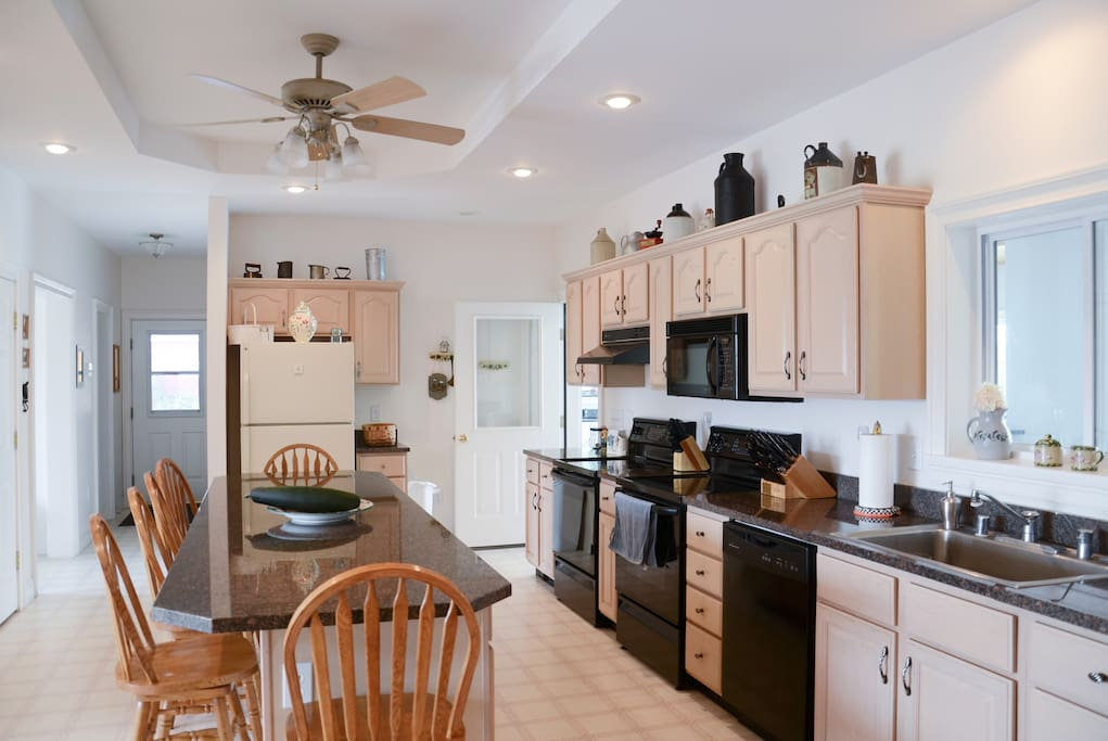 Eat in kitchen; granite center island, two stoves, dishwasher, and guest refrigerator (not pictured).
