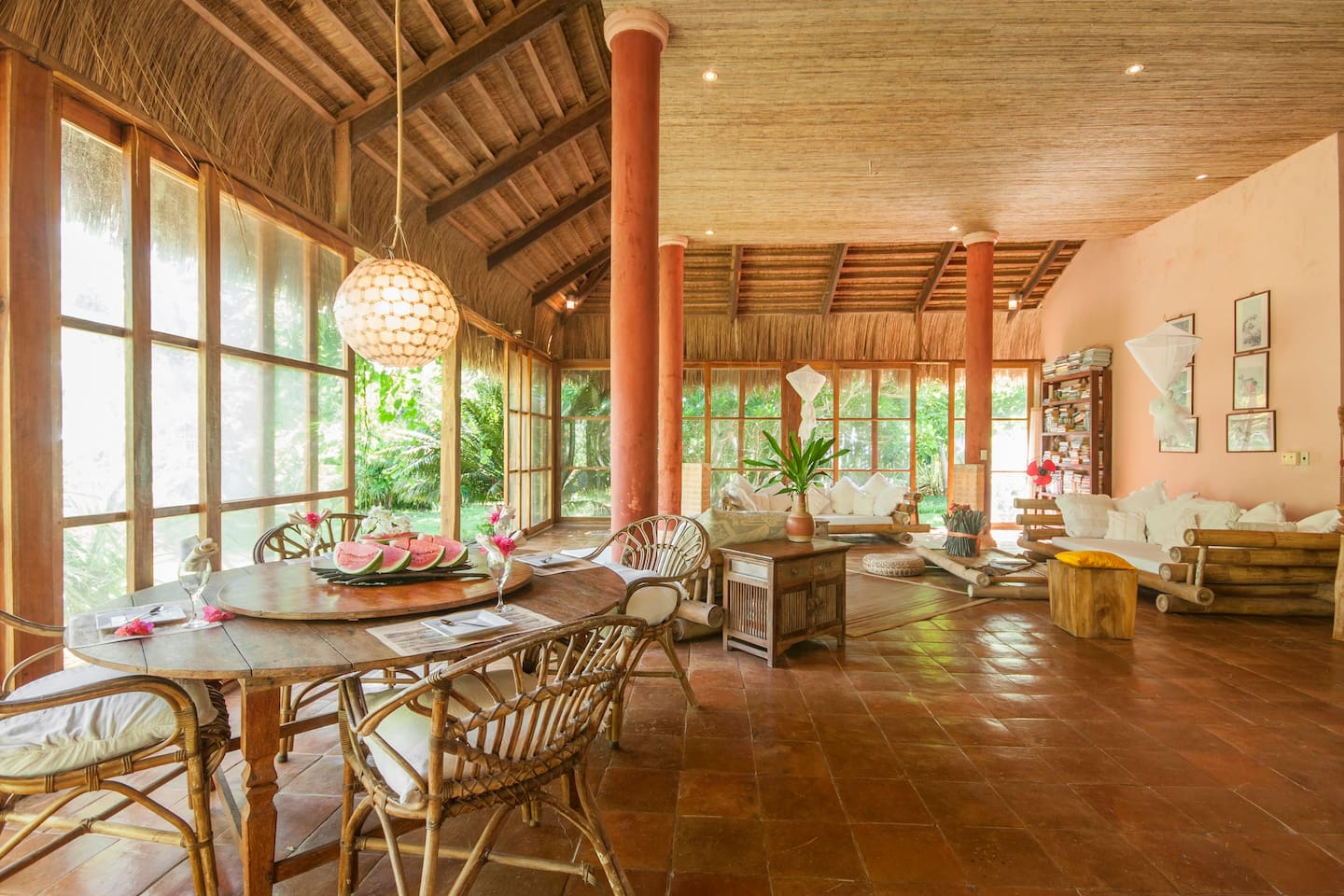 Spacious open living and dining area surrounded by light, a cooling breeze and lush gardens.