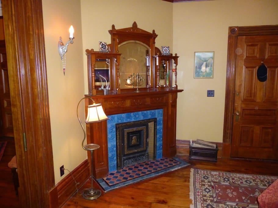 Cherry wood mantel adorns working fireplace