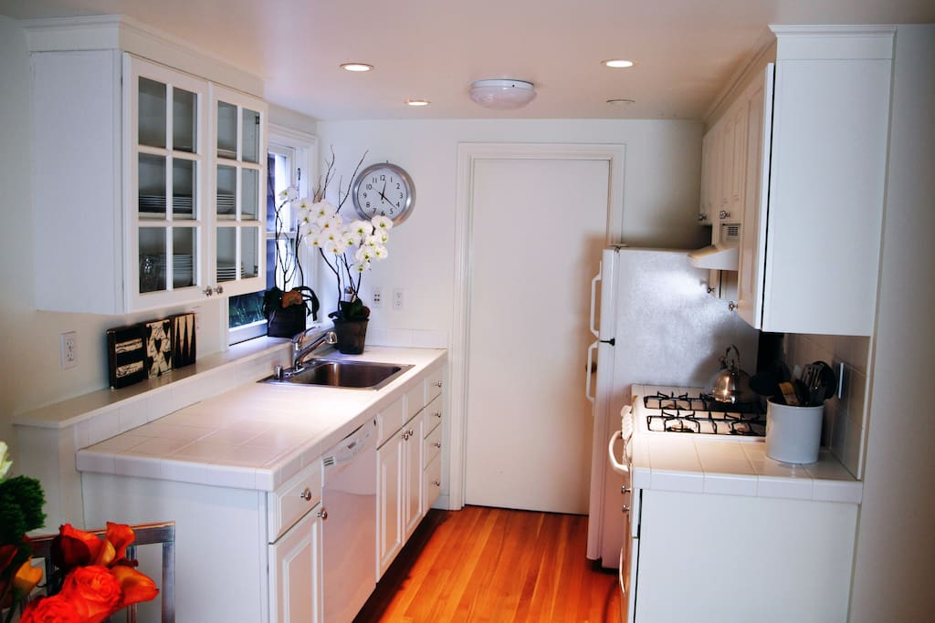Your personal kitchen.  Stocked with Pottery Barn plates, bowls, pots, pans utensils, microwave, oven, fridge, and dish washer.