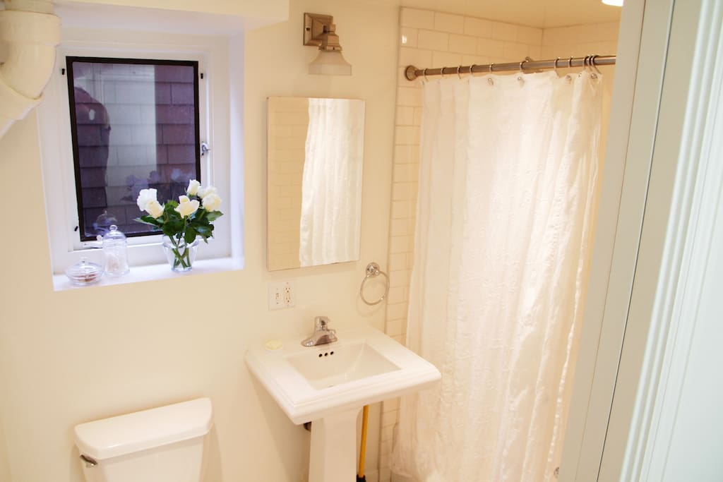 Bathroom with bath tub, shower, and sink.  100% thick cotton towels included with your stay.