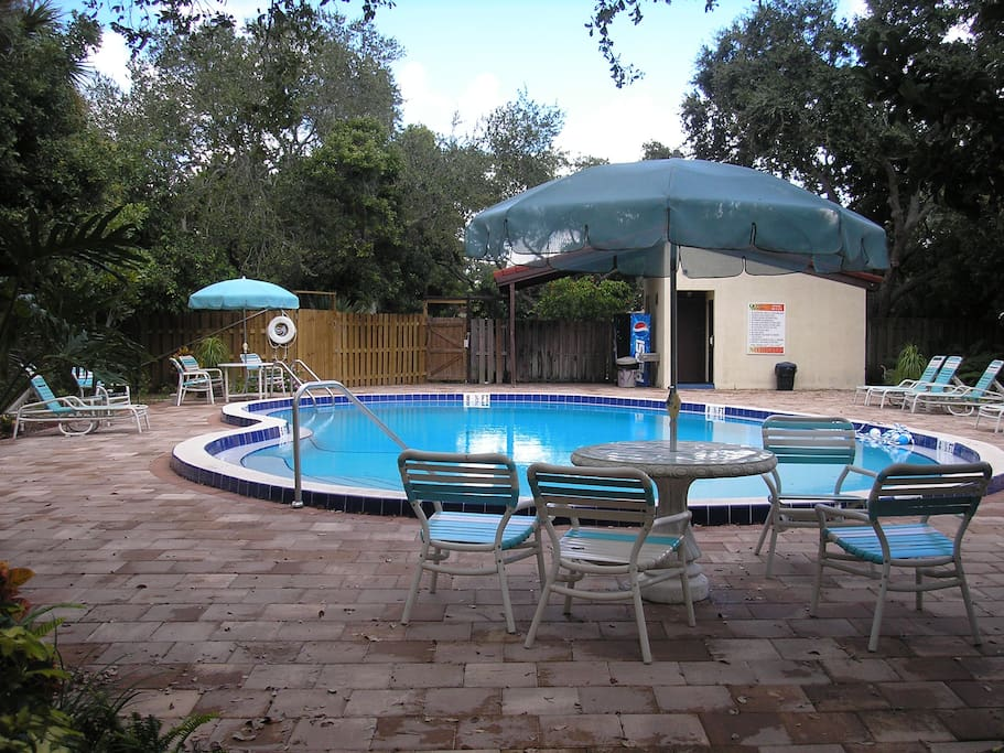 Opposite view of adult pool.  Family pool is out the gate and across drive.