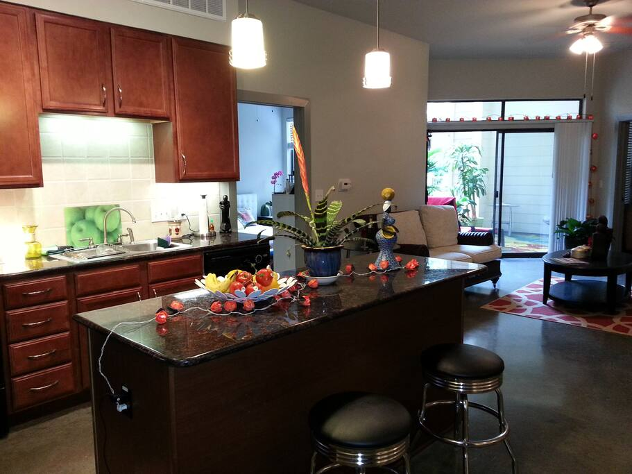 Spacious gourmet kitchen with dining area and living room opening to the patio.