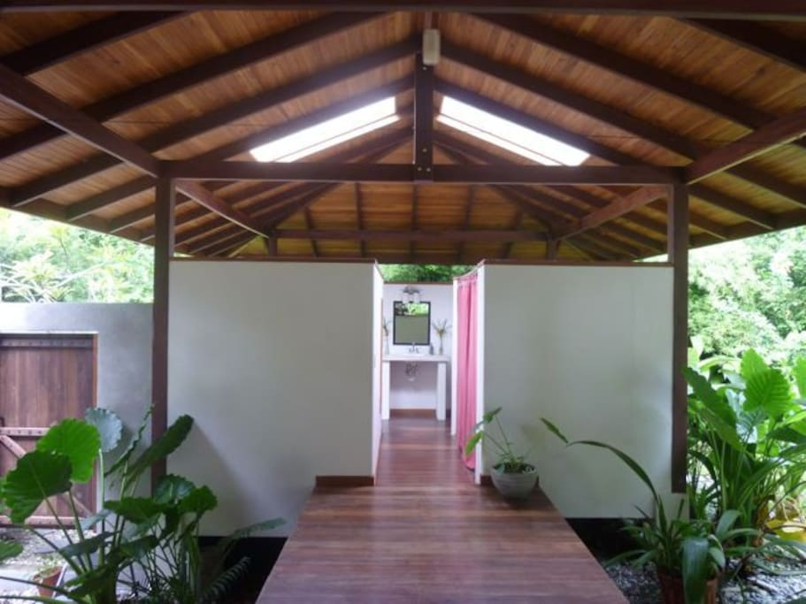 The full bathroom is connected to the main house by covered walkway