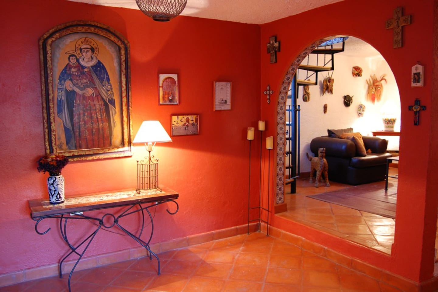 Foyer and living room with Mexican folk art and tiled archways