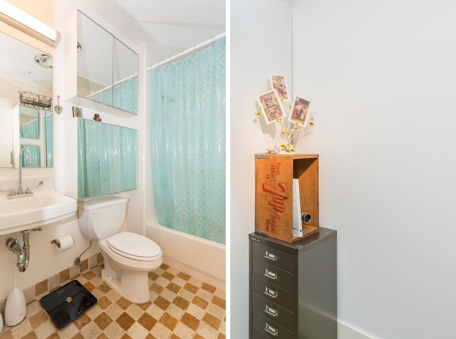 Spotless bathroom with vintage teal shower curtain and Withings scale. The detail on the right of the vintage 7up box holds some cool magazines and faces the queen size bed in the bedroom area.