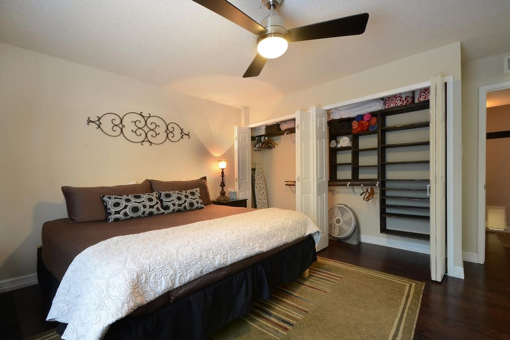 Downstairs master bedroom. Large closet with beach towel and extra pillow and bedding