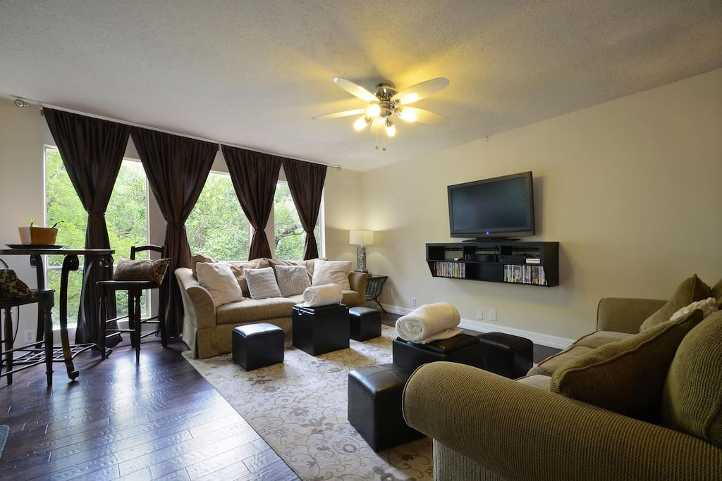 Open Light Bright Living Room, Pub Table, Bar and direct access to tree lined balcony!