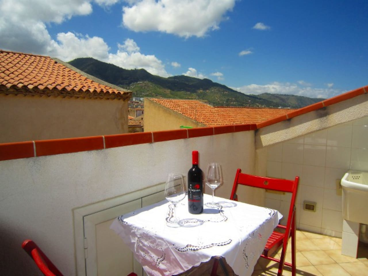 Balcony on the upper level where is possible to sit, have a dinner and drink a tasty glass of Sicilian wine