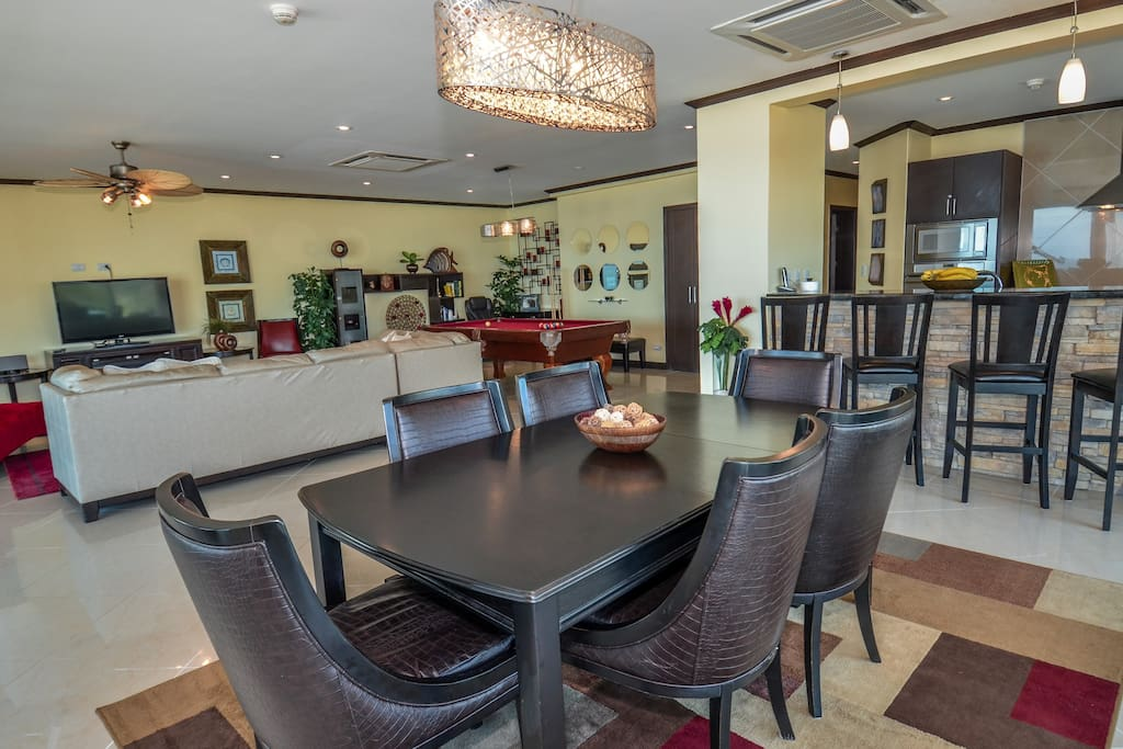 Dining room, breakfast bar and living room/pool table in the background