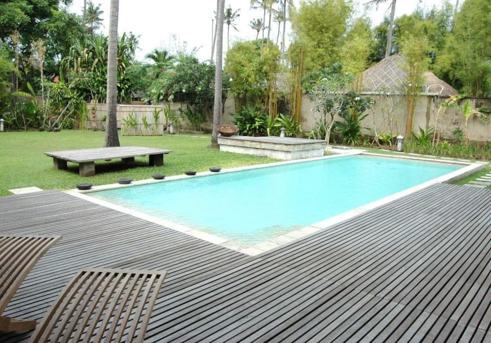 pool, deck  and large flat grass garden. we do not use varnishes on our wood so deck wood is always a weathered grey finish