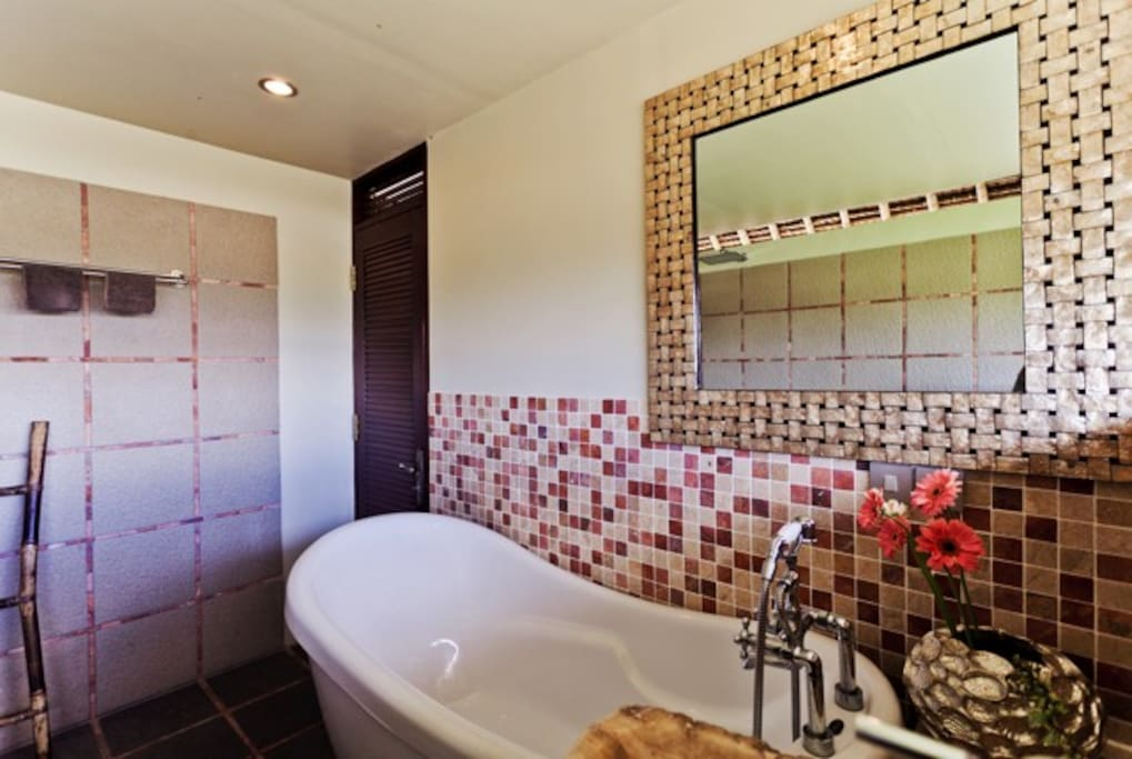 Bathroom with bath tube and shower