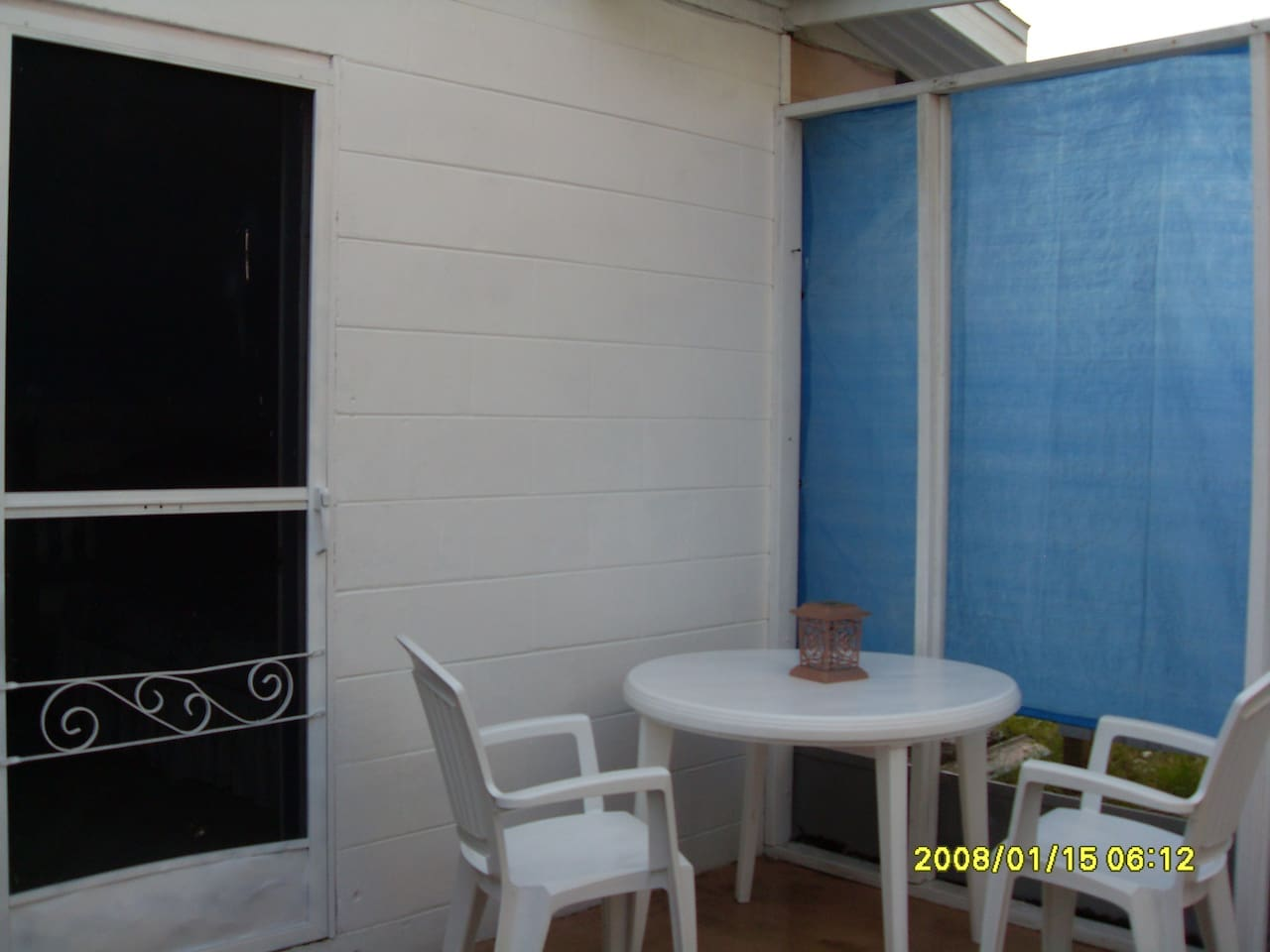 Enjoy the outdoors without going outside on this fully screened rear patio