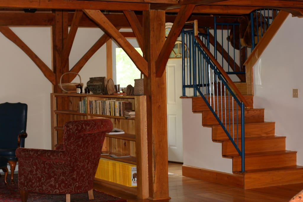 Library and center stairs that lead up to the main guest bedrooms.