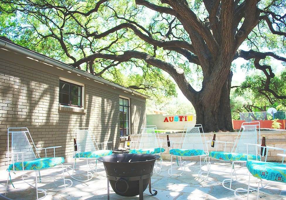 One of the best patios in Austin with rockers (they have drink holders!), fire pit and a killer 250 year old oak.