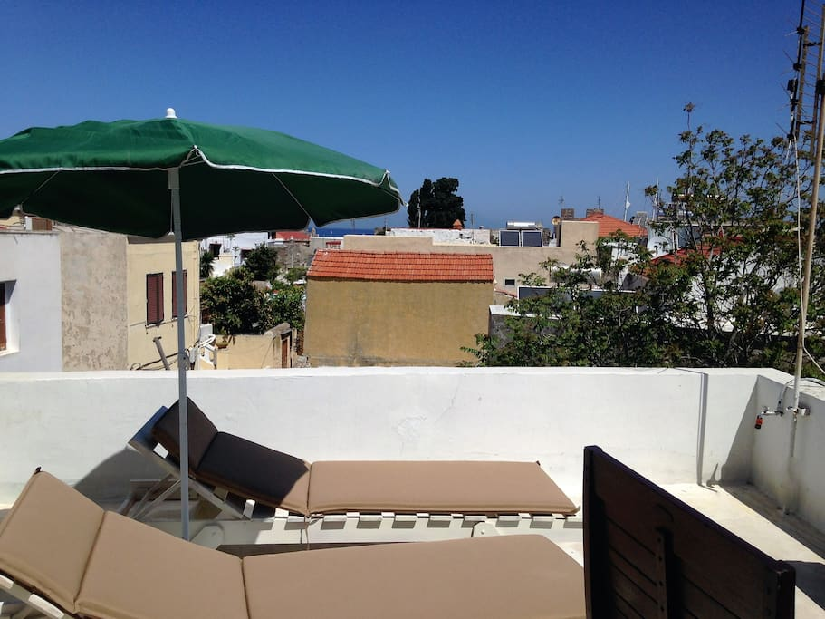 the roof terrace and sun loungers with view