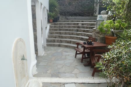 two stone build beds garden view in town 121 - Mykonos