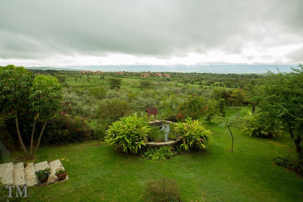 View over the garden, pond and Lake Naivasha