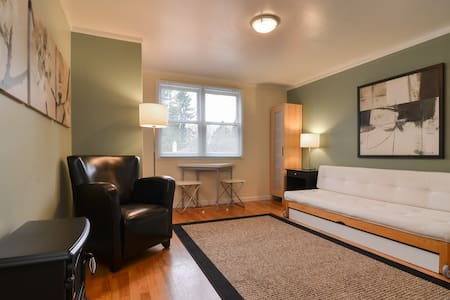 Contemporary studio apartment with lots of natural light, second floor of our Mapleleaf home. Separate entry from raised private deck. Walk to Cafes, Restaurants.  Five minutes drive to UW and 10 minutes from Downtown