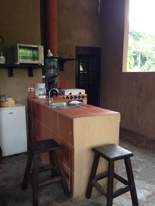 Kitchen with gas stove top, electric toasted oven, coffee maker and blender.