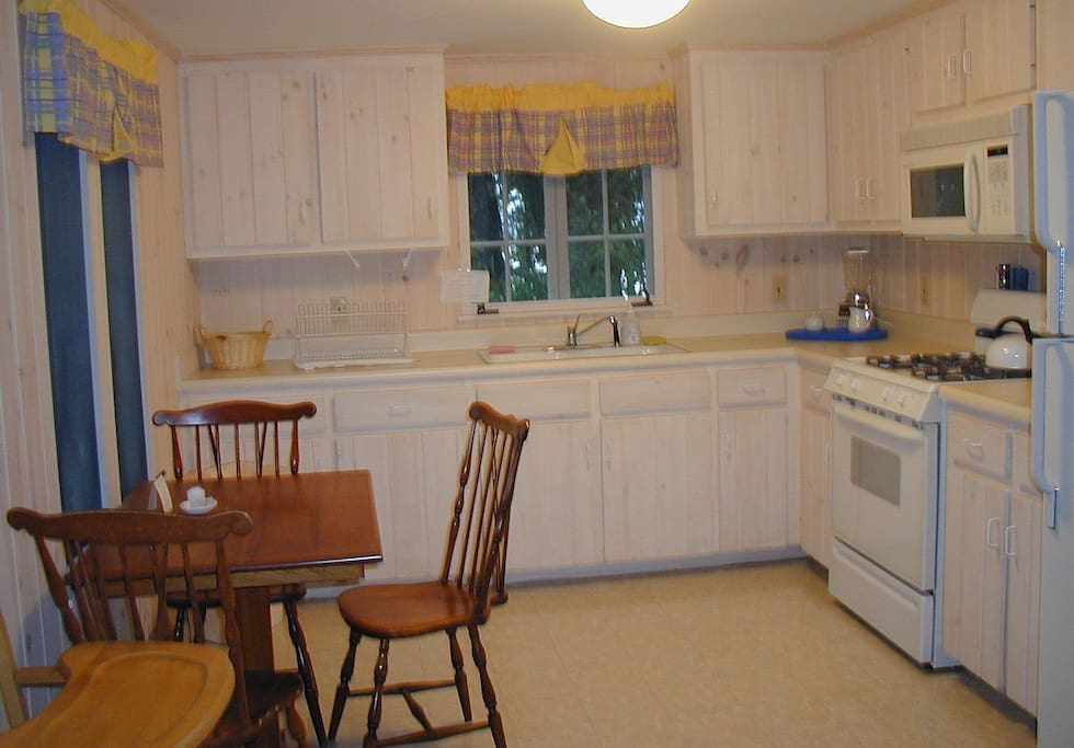 Kitchen equipped with essential items. Full size fridge, microwave and stove.