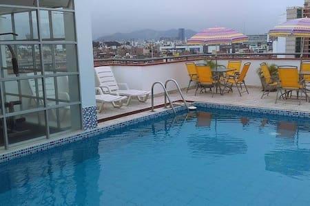 Bedroom + pool + gym