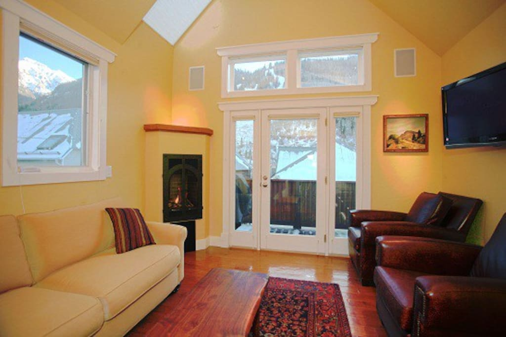 Cozy living room with exceptional views, fireplace, deck and flat screen TV