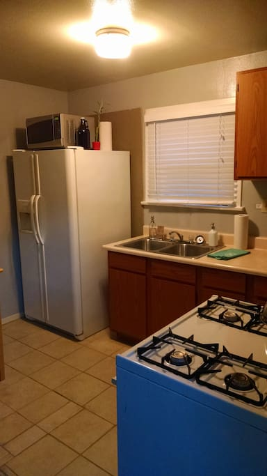 One more kitchen photo, of the sink and refrigerator.