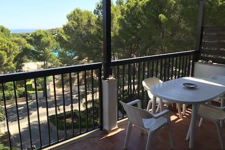 Apartamento con vistas a la playa y bosque - Condomínio