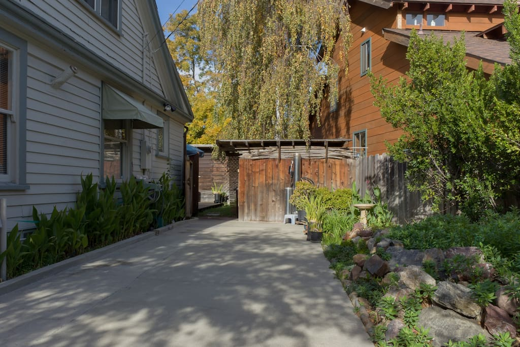 Park in private driveway and walk through gate to studio