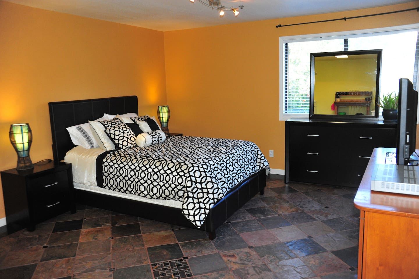 Queen sized bed with memory foam topper.