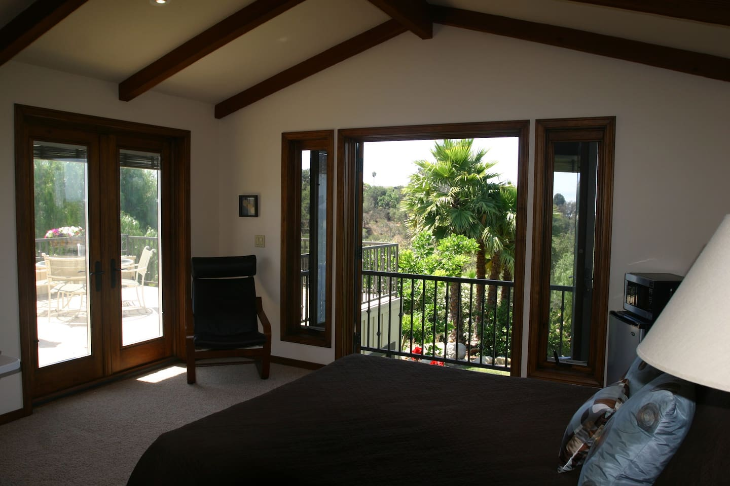 Two French Doors Leading to Deck and Balcony