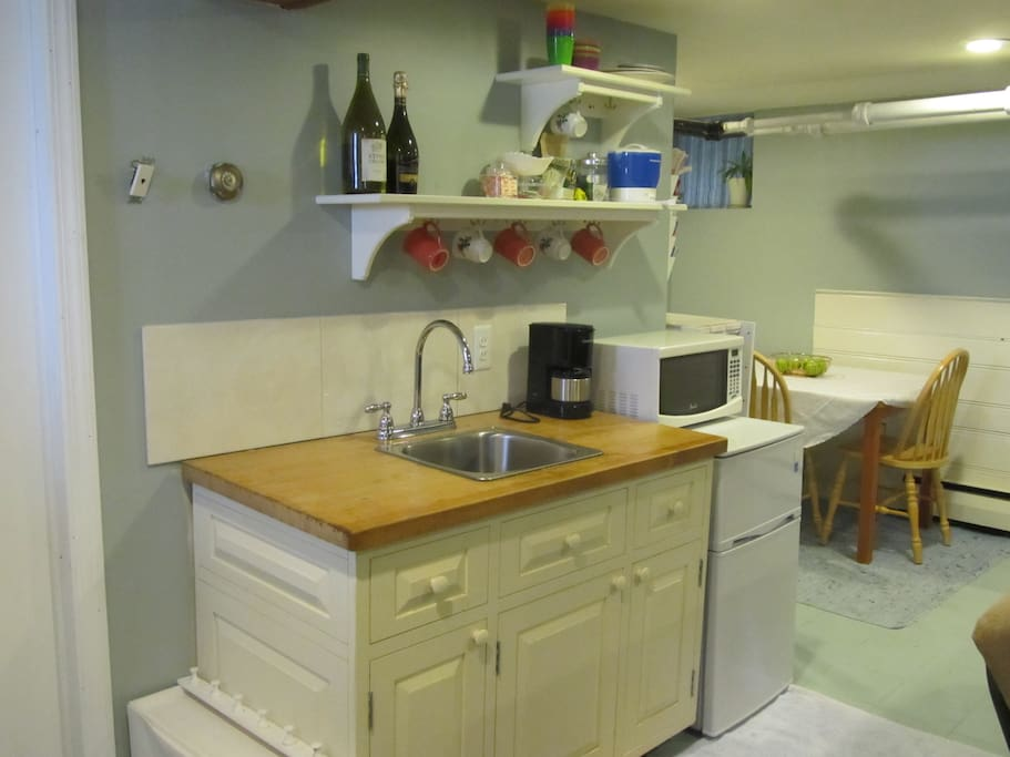 Kitchenette: sink, mini-fridge, microwave, coffee pot, and hot pot
