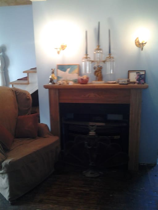 Cottage living room with working gas mantle