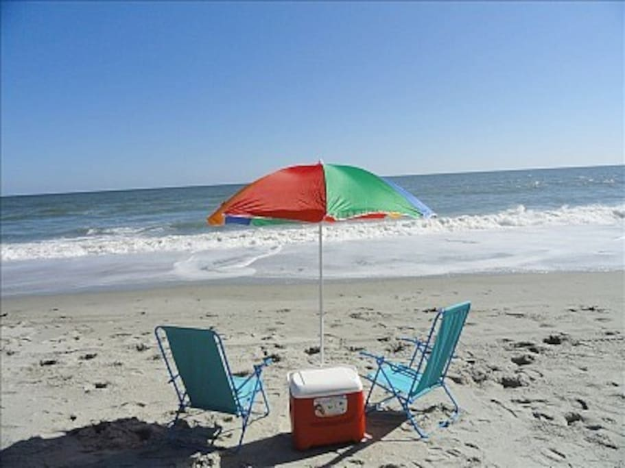 Rental includes a cooler, umbrella, 2 beach chairs, 2 boogie boards, and sand toys