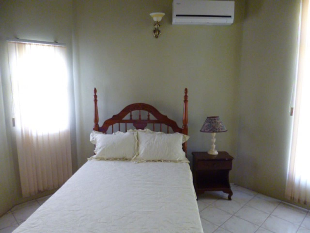 Midsize bedroom. Double bed and Air Conditioning shown