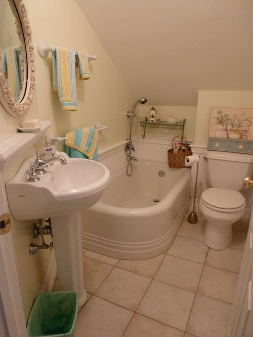 Upstairs bathroom has bathtub and hand held shower.