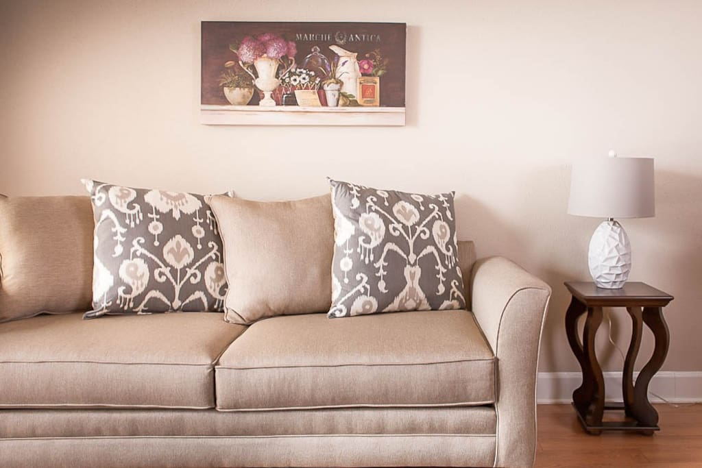 Sofa with pull out queen size mattress.