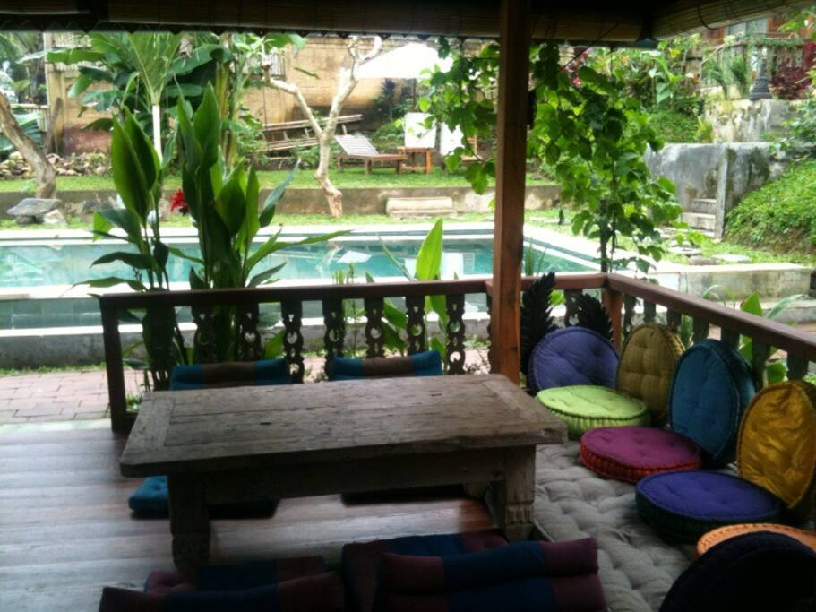 Intimate wooden lumbung with pool